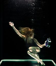 Girl underwater with clock.jpg